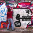 Woman and graffitti. — Stock Video