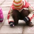 Children drawing on asphalt panning — Stock Video #12354532