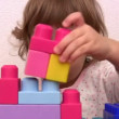 Little girl with toy cubes — Stock Video