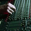 Stock Video: Hands on mixing sound board