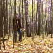 Man in autumnal wood — Stock Video