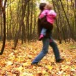 Dancing father with girl in autumn park — Stock Video #12356354