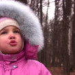 Little girl with fur hood in park — Stock Video #12357860