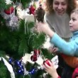 Mother with children watching christmas tree in shop — Stock Video #12358236