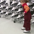 Little girl with skates in shop — Wideo stockowe