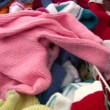 Baby clothes in shop panning — Stock Video #12358598