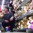 Family with boy in toy shop — Vídeo Stock