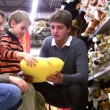 Stock Video: Family with boy in toy shop