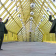 Stock Video: Jumping happy two businessmen on bridge