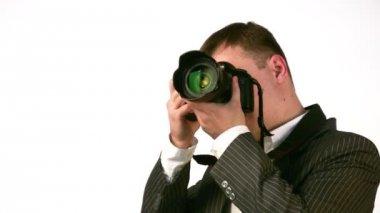 Affärsman med digital foto kamera ansikte — Stockvideo
