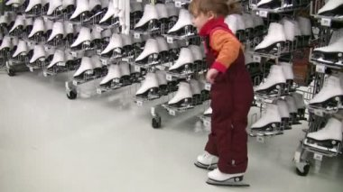 Little girl with skates in shop — Stock Video