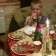 Father, mother and woman with four children sitting at festive table — Stock Video #12360436