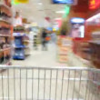Stock Video: Pushcart goes to shop. Time lapse