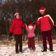 Stock Video: Family with jumping little girl with christmas hats