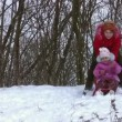 Woman with little girl on sled — Stock Video