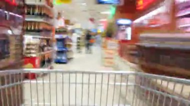 Pushcart goes to shop. Time lapse — Stock Video