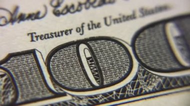 Numeral one hundred dollar bills macro, rotating — Stock Video