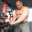 Shirtless bodybuilder opening furnace in locomotive — Stock Video