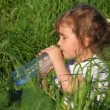 Girl drinking water from bottle, eating apple and smiling — Stock Video #13786465