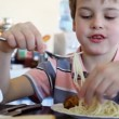 Stock Video: Boy eats noodle