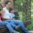 Mother reading book with kids — Stock Video #13786544