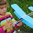 Little girl playing with toy airplane outdoor — Stock Video