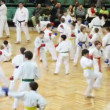 Trainer and kids in sports hall are doing exercise on promotion examination in style of Goju-ryu Karate-Do — Stock Video