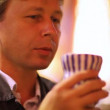 Man drinks from  cup - Stok fotoraf