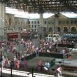 Stock Video: Station and crowds on it. Time lapse