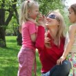 Ma and girls in park — Stock Video #13786925