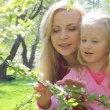 Stock Video: Ma with girl in garden