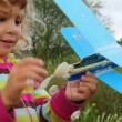 Portrait of little girl playing with toy airplane outdoor — Stock Video