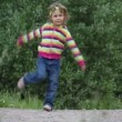 Stock Video: Little girl dancing on the road
