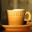 Cup with hot coffee on saucer. Time lapse. Moving shadow - Stock Photo