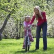 Girl learns sit on bicycle — Stock Video