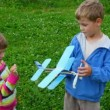 Boy and little girl playing with toy aircraft — Stock Video