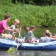 Family with 4 kids in rubber boat, rowing — Stock Video