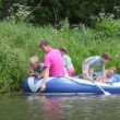 Family with 4 kids in rubber boat, fishing — Stock Video