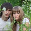 Young man and girl staring at something - Stockfoto