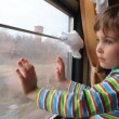 Girl looking through window on  moving train — ストックビデオ