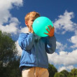 Boy with blue balloon in park - Stock Photo