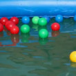 Boy swimming after colorful balls — Stock Video