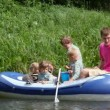 Family with 4 kids in rubber boat, fishing — Stock Video #13788120