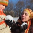 Mother and son do snowball — Stock Video