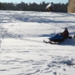 Stock Video: Snowmobile quickly goes