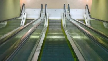 Camera moving down on escalator — Stock Video