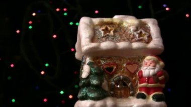 Decorative toy house Santa Claus revolves around its axis — Stock Video