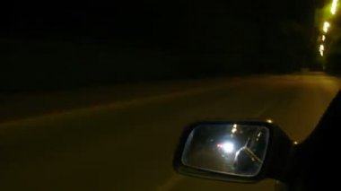 View in mirror of the car during trip on night city. Time laps — Stock Video