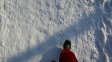 Legs in the red pants and black boots walking on snow — Stock Video