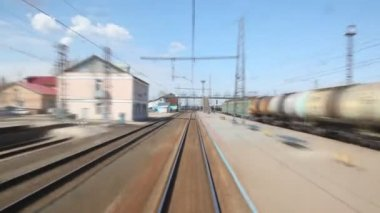 Small Russian train station, tracks and cisterns from moving train — Stock Video